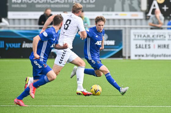 Blair Yule in action for Cove Rangers against Montrose.