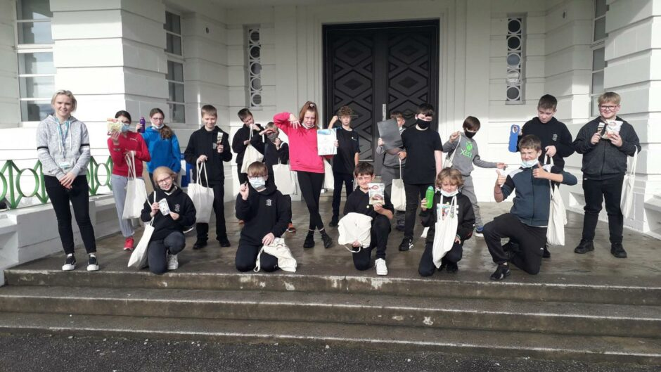 Inverness pupils show off their new water bottles, colouring books and other goodies from the High Life Highland mental health wellbeing packs.