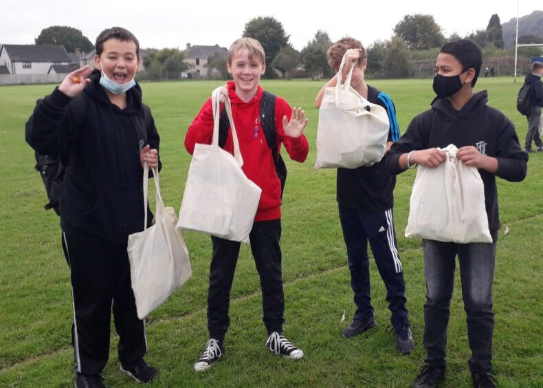 Inverness High School pupils give thanks for their wellbeing packs.