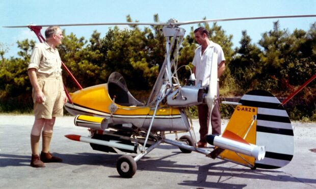 Picture from the film You Only Live Twice showing Sean Connery as James Bond by the gyroplane Little Nellie.