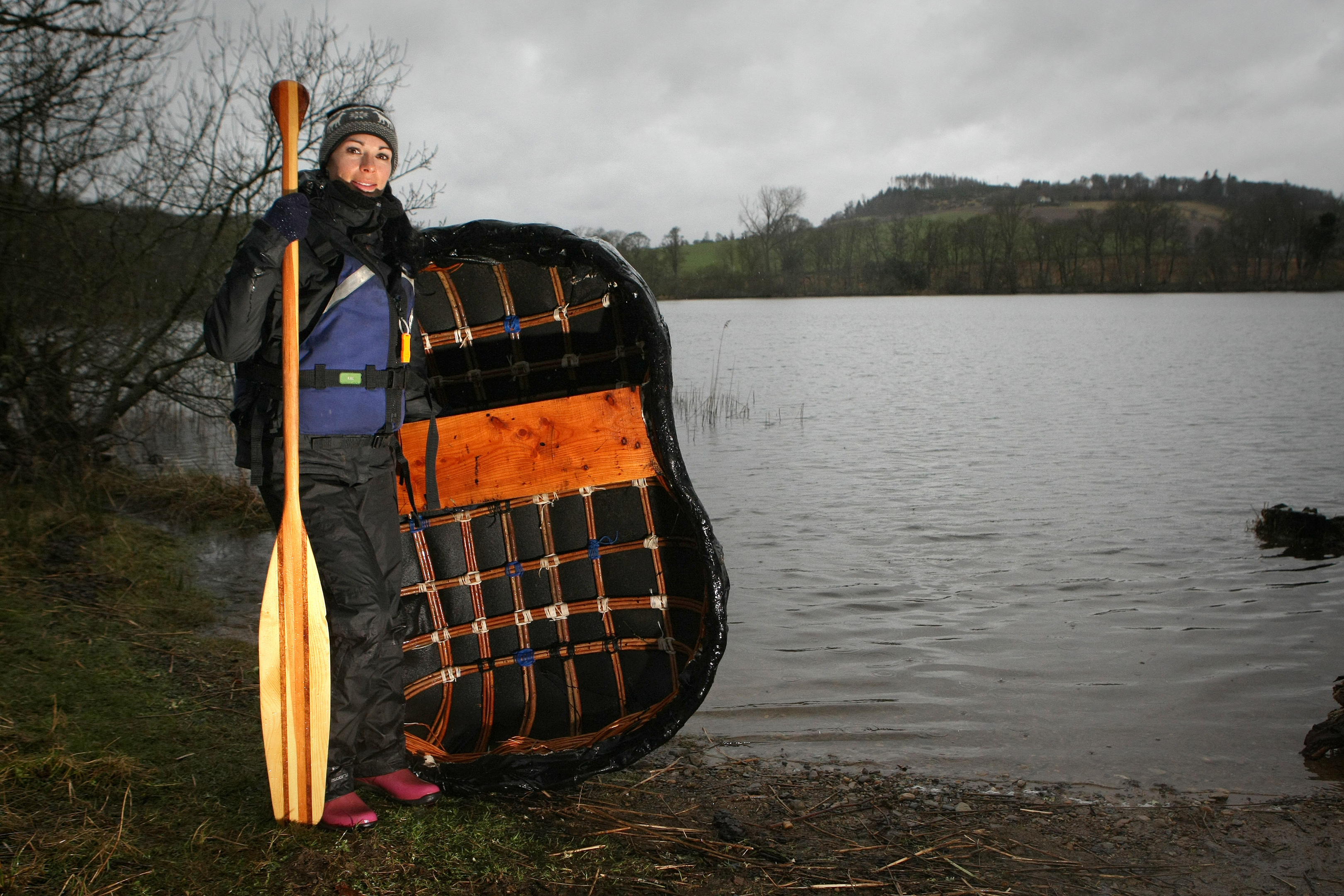 Gayle and her coracle at Clunie Loch.