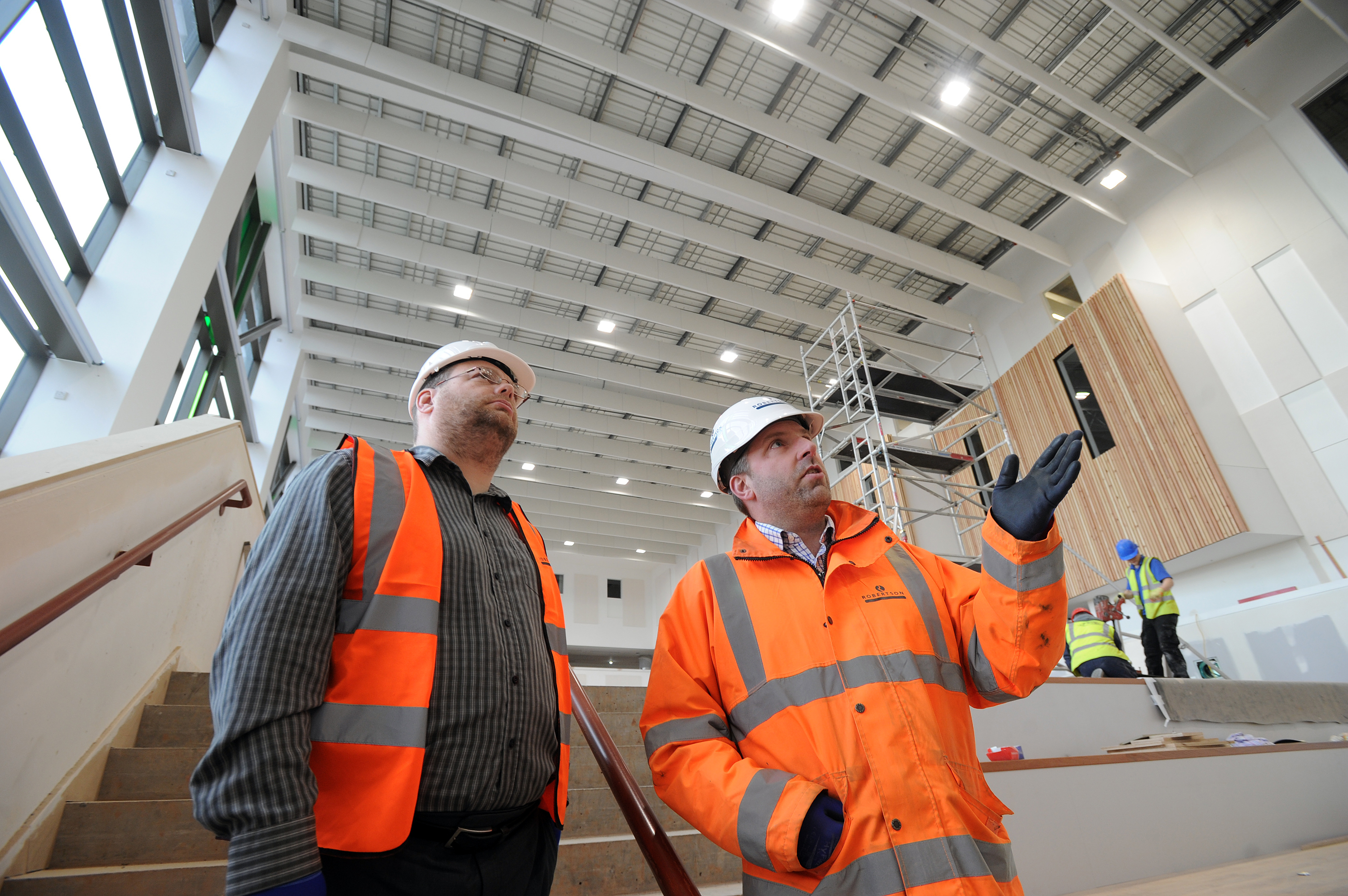 Councillor Stewart Hunter and project manager Mark Dalziel survey the new Harris Academy. When it fully opens in August, Mr Hunter believes it will be one of many schools to finally boast a full complement of teachers.