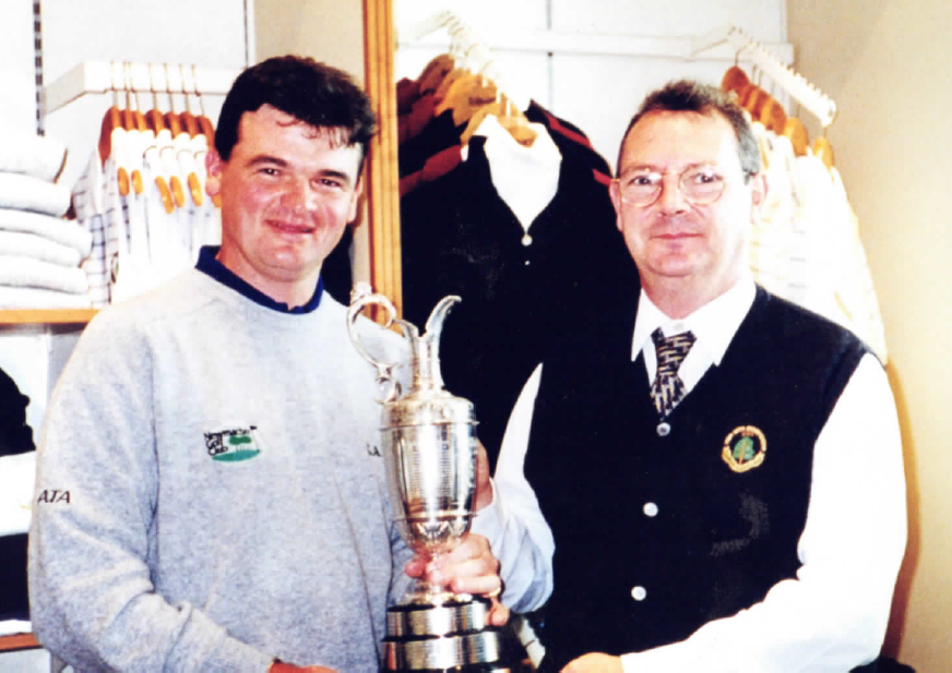 Mr Roy, right, with Paul Lawrie after the Scot triumphed at the 1999 Open at Carnoustie.