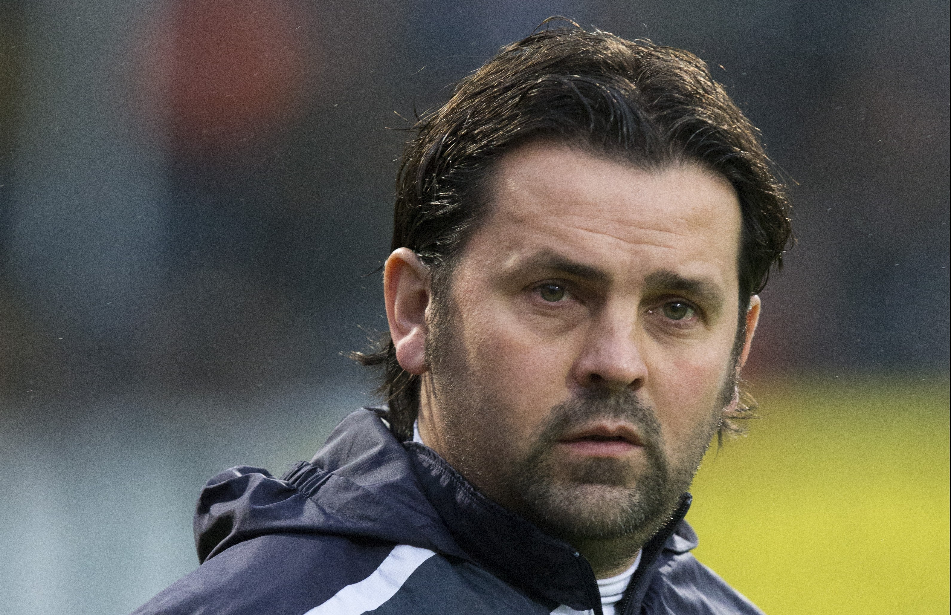 Former Dundee FC manager Hartley is pursuing the club for unpaid wages