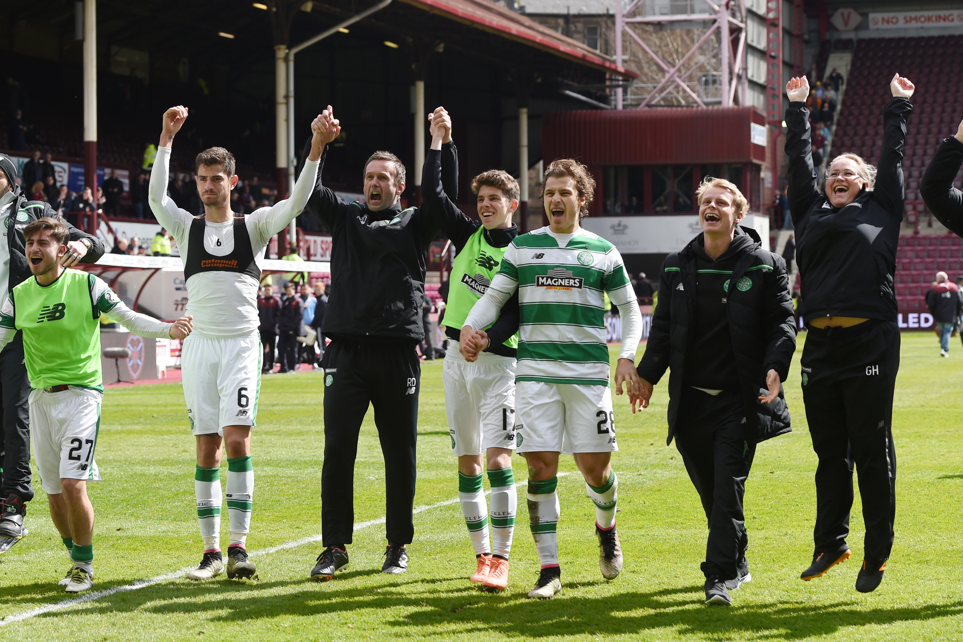 Celtic celebrate after the match, having all but won the title.
