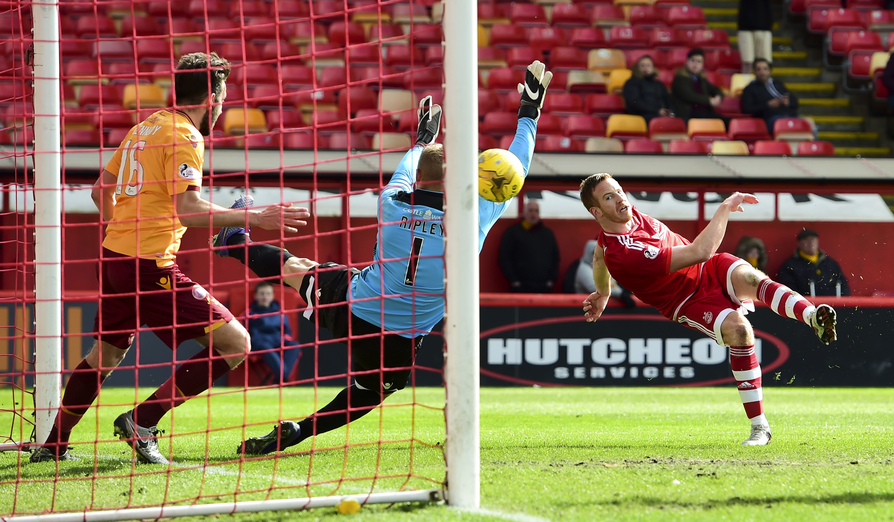 Aberdeen's Adam Rooney (right) fires in the third goal.