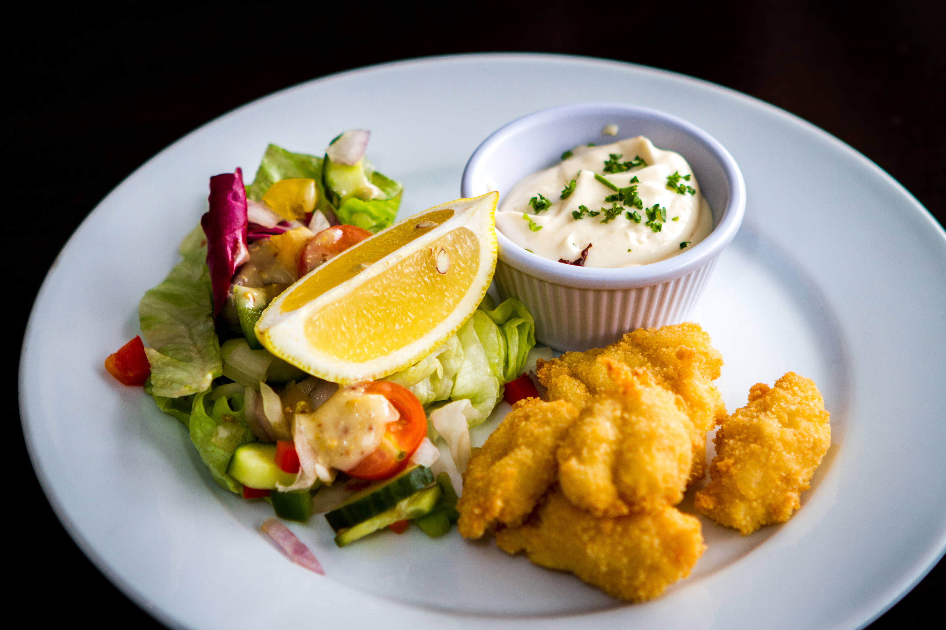 The Alyth Hotel's fresh scampi tails coated in homemade breadcrumbs served with a crisp salad and Aioli.