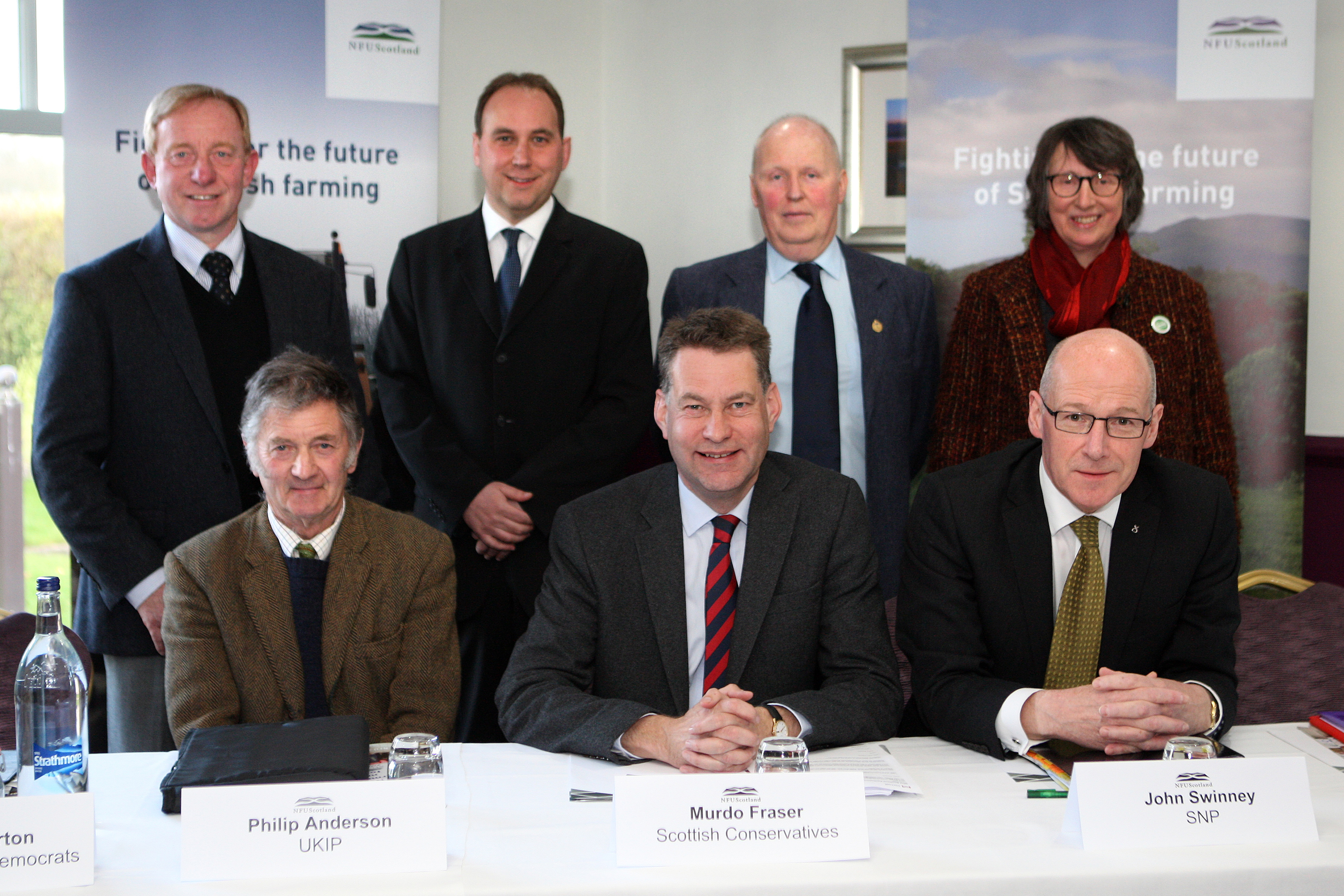 Politicians lined up to win farmers votes. Back L/R, Willie Robertson (Lib Dem), Thomas Docherty (Labour), Roddy Kennedy (Chairman) , Louise Ramsay (Green) . Front Philip Anderson (UKIP), Murdo Fraser (Conservative) and John Swinney (SNP).