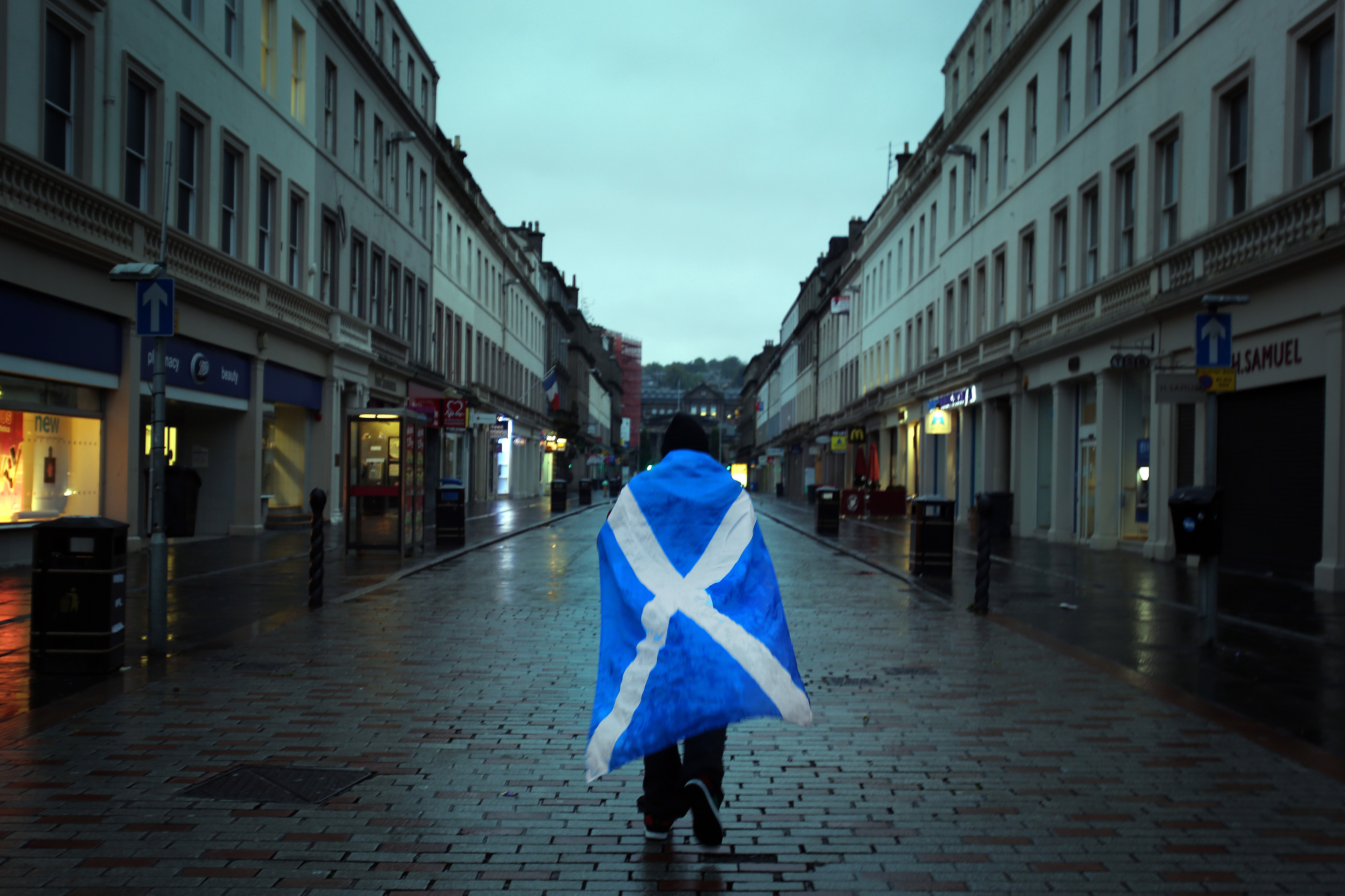 A dejected independence supporter heads home in Dundee after the last referendum.