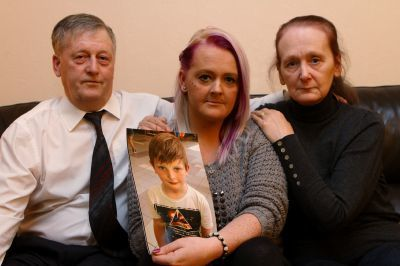 Laura Mckay with a picture of her son Kairon, and her parents Hector and Moira Mckay.