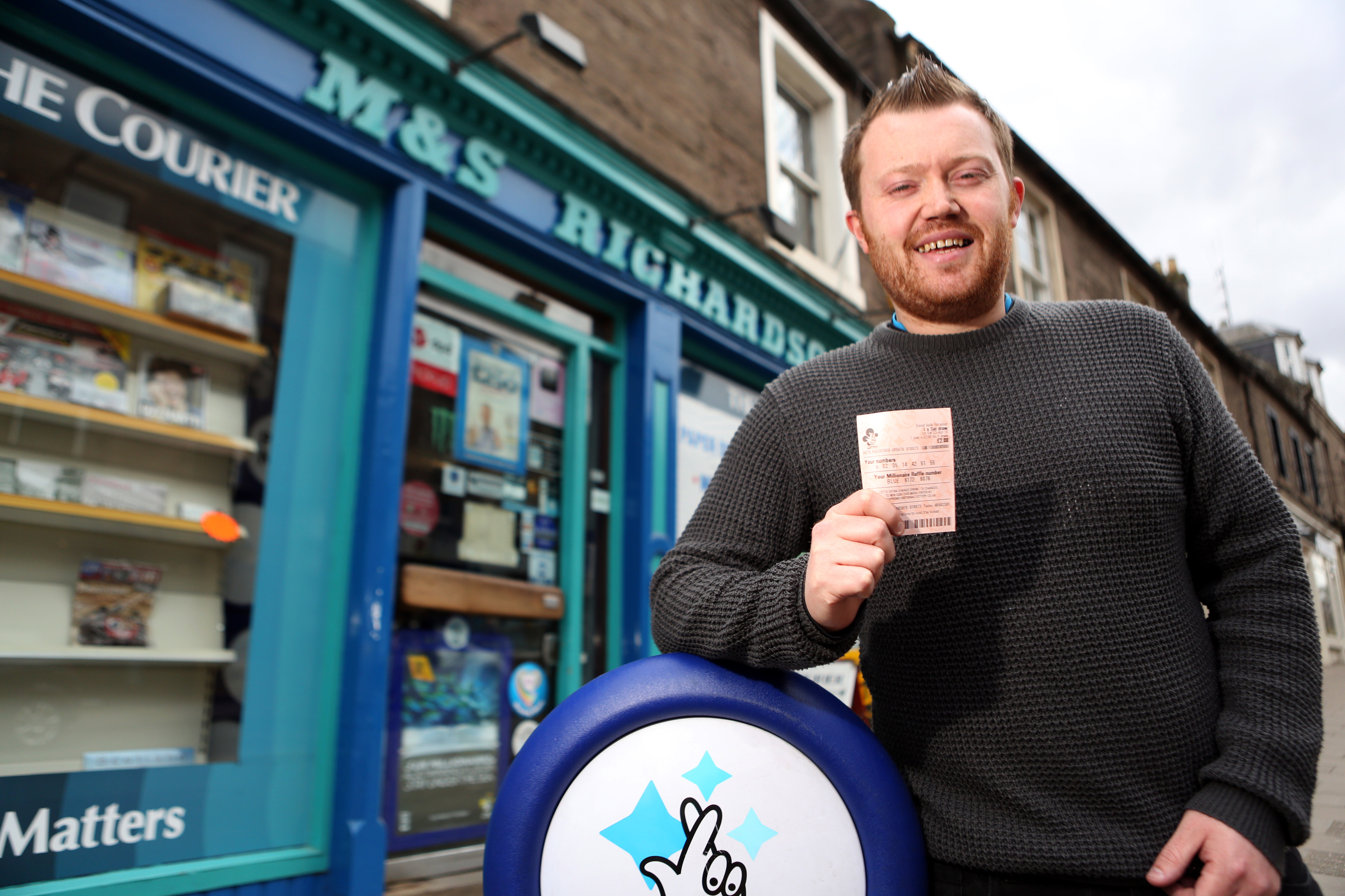 Clive Myles  with his ticket outside Richardson's in Forfar