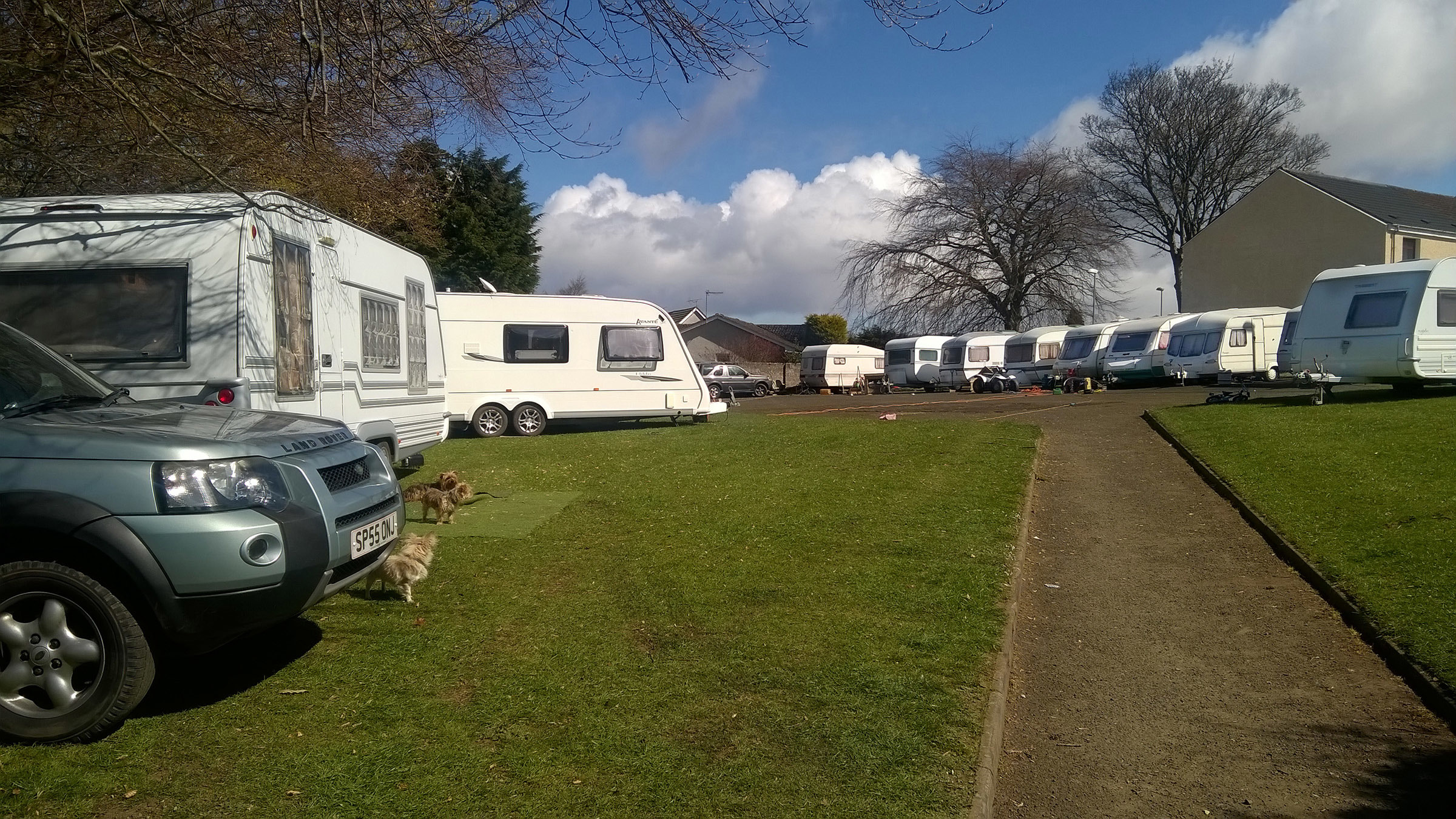 The caravans and vehicles at the end of the lane between Westfield Drive and Threewells Drive.