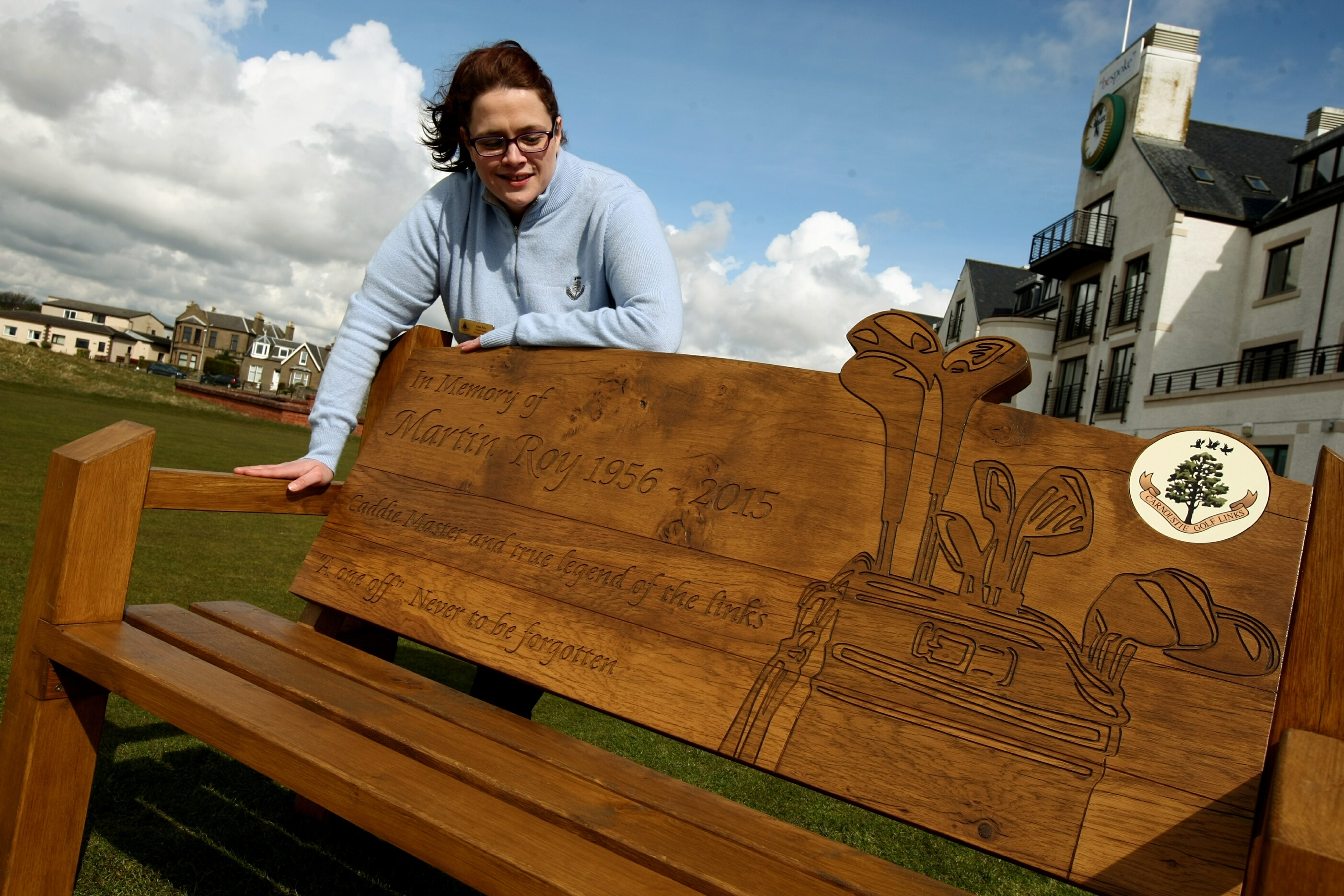 Ailsa Roy, daughter of caddie legend Martin, at the memorial bench.