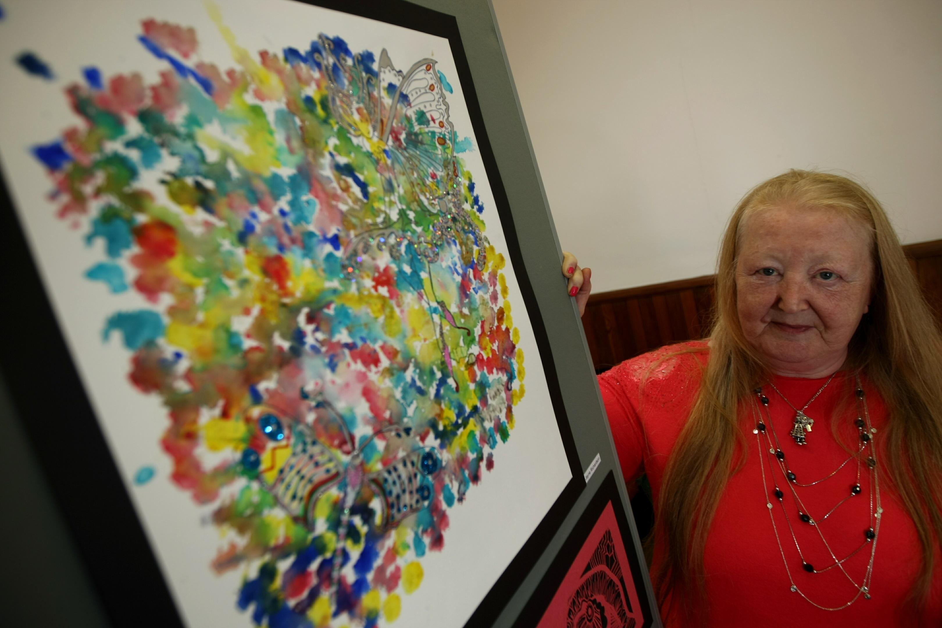 Jayne Richardson, beside her artwork.