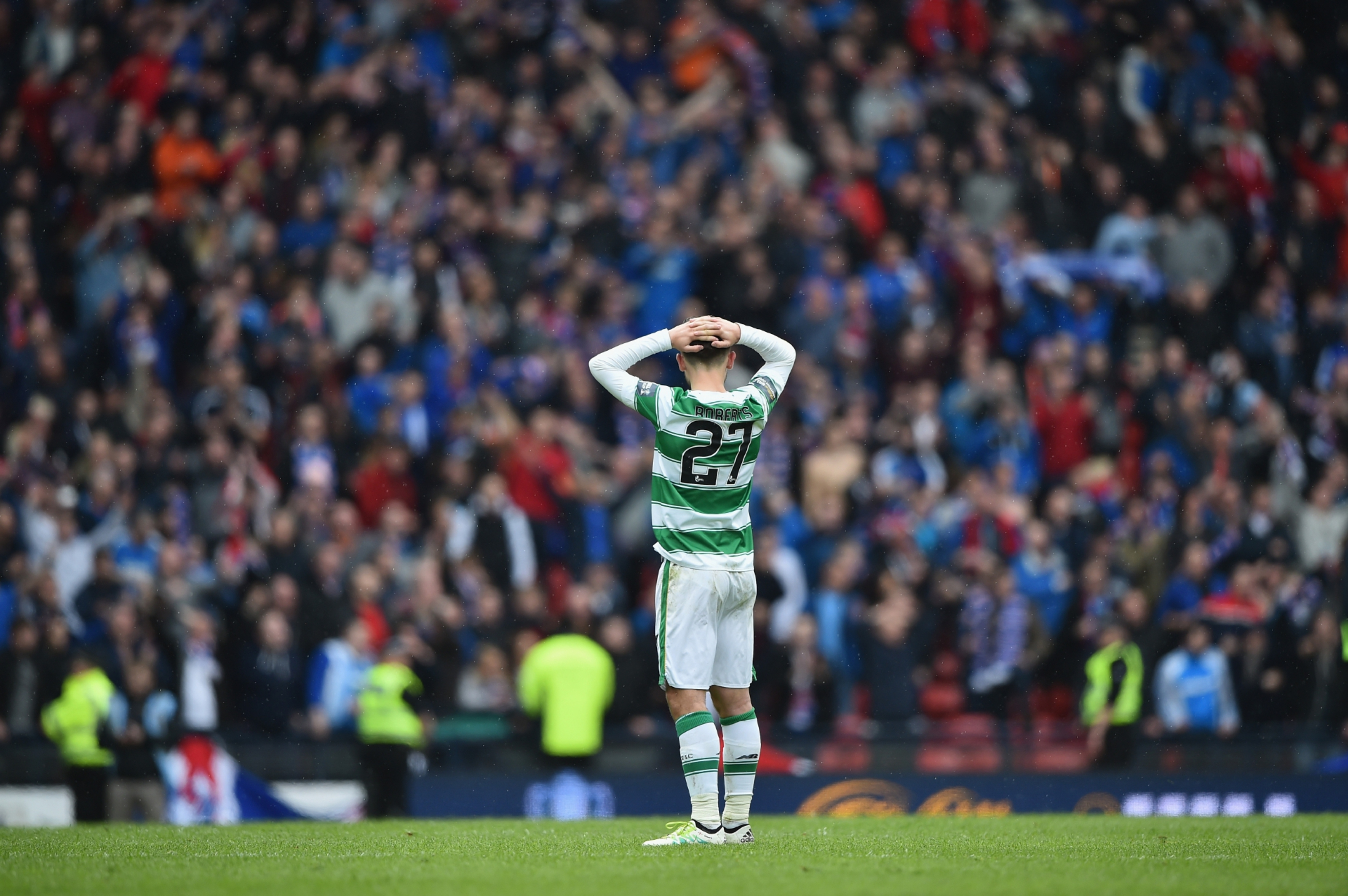 Patrick Roberts holds his head in his hands at full-time.