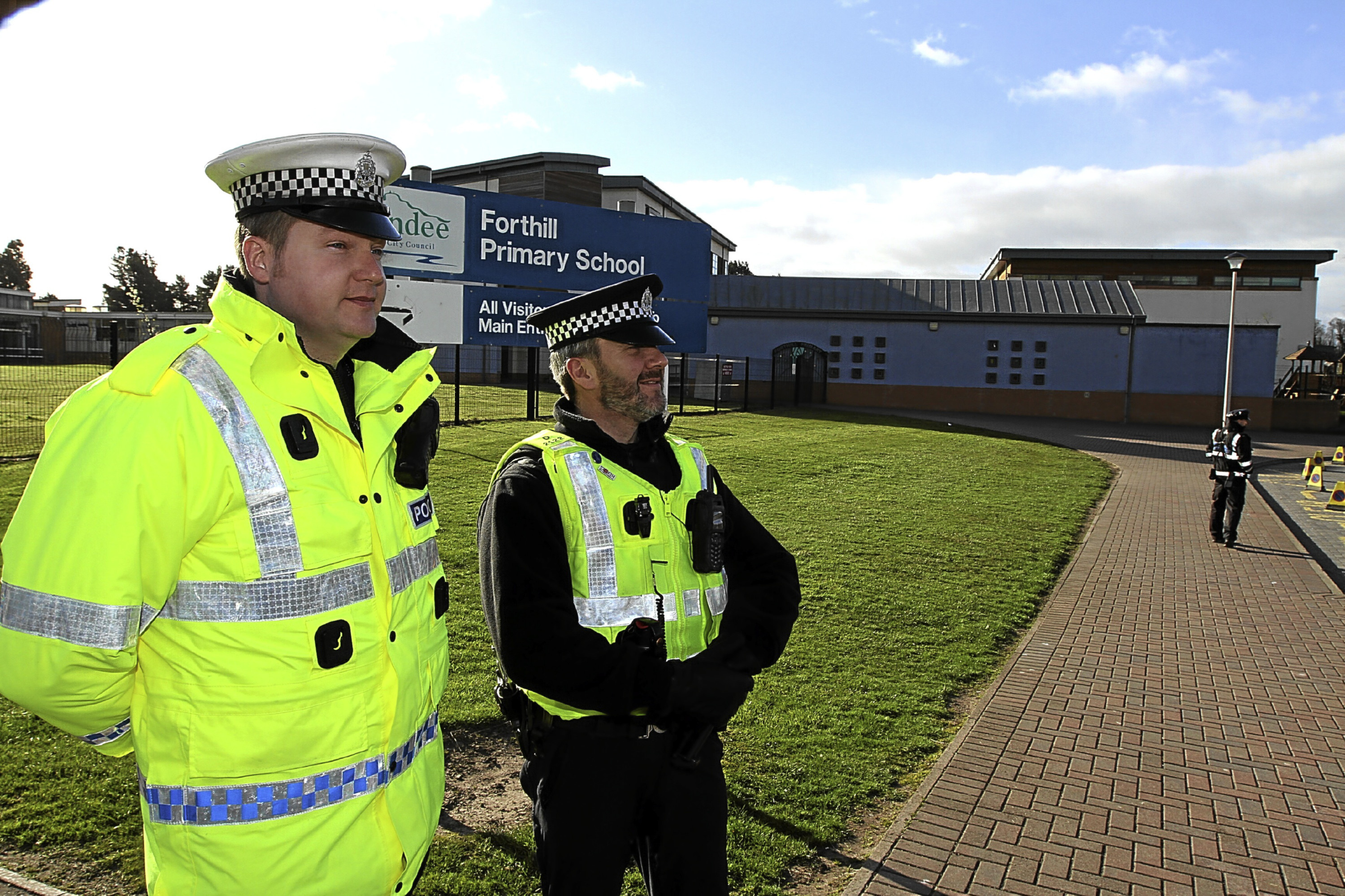 PC Gordon Dickson of the Road Policing Unit, with PC Darren Banister, Broughty Ferry Community Policeman,outside Forthill primary school to check on parking habits by parents in a previous police visit.