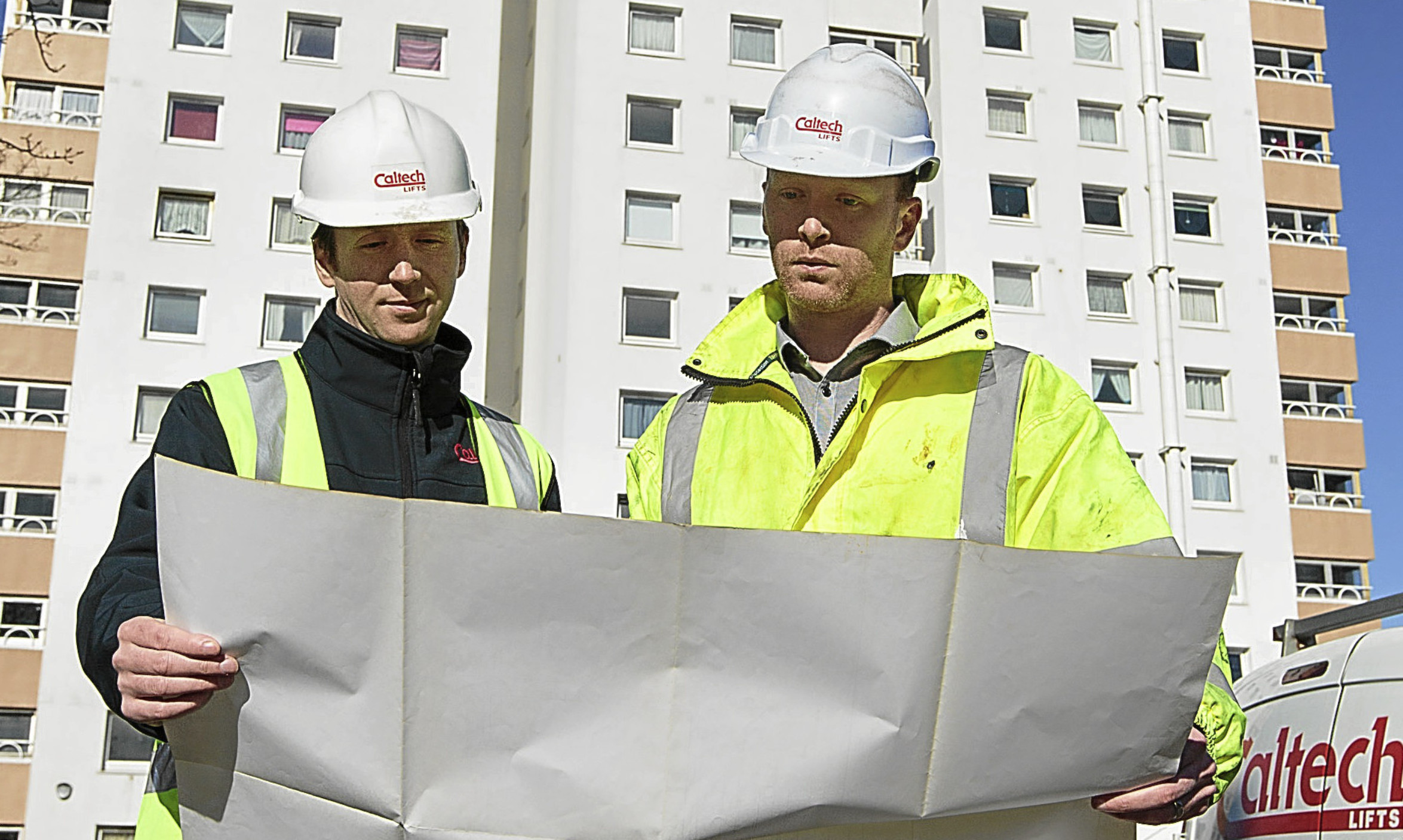 Caltech Lifts Managing Director Andrew Renwick (left) looks over the plans for Ancrum Court with his brother and fellow director, Fraser Renwick.