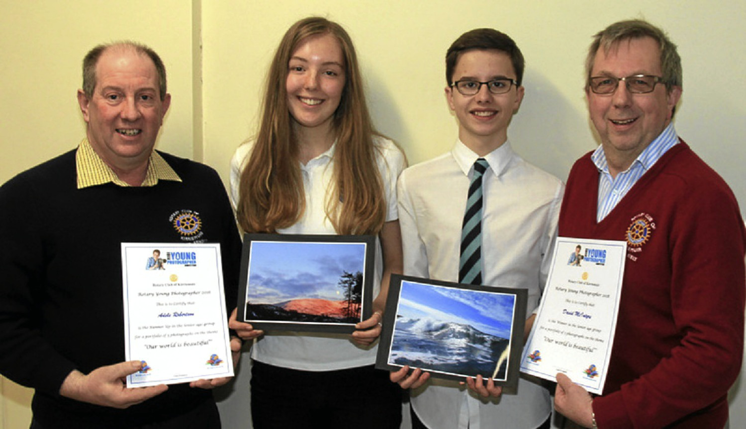Kirriemuir Rotary Club president Mike Kiely (right) and Youth Service convenor James Arnott present certificates to David and Adele.