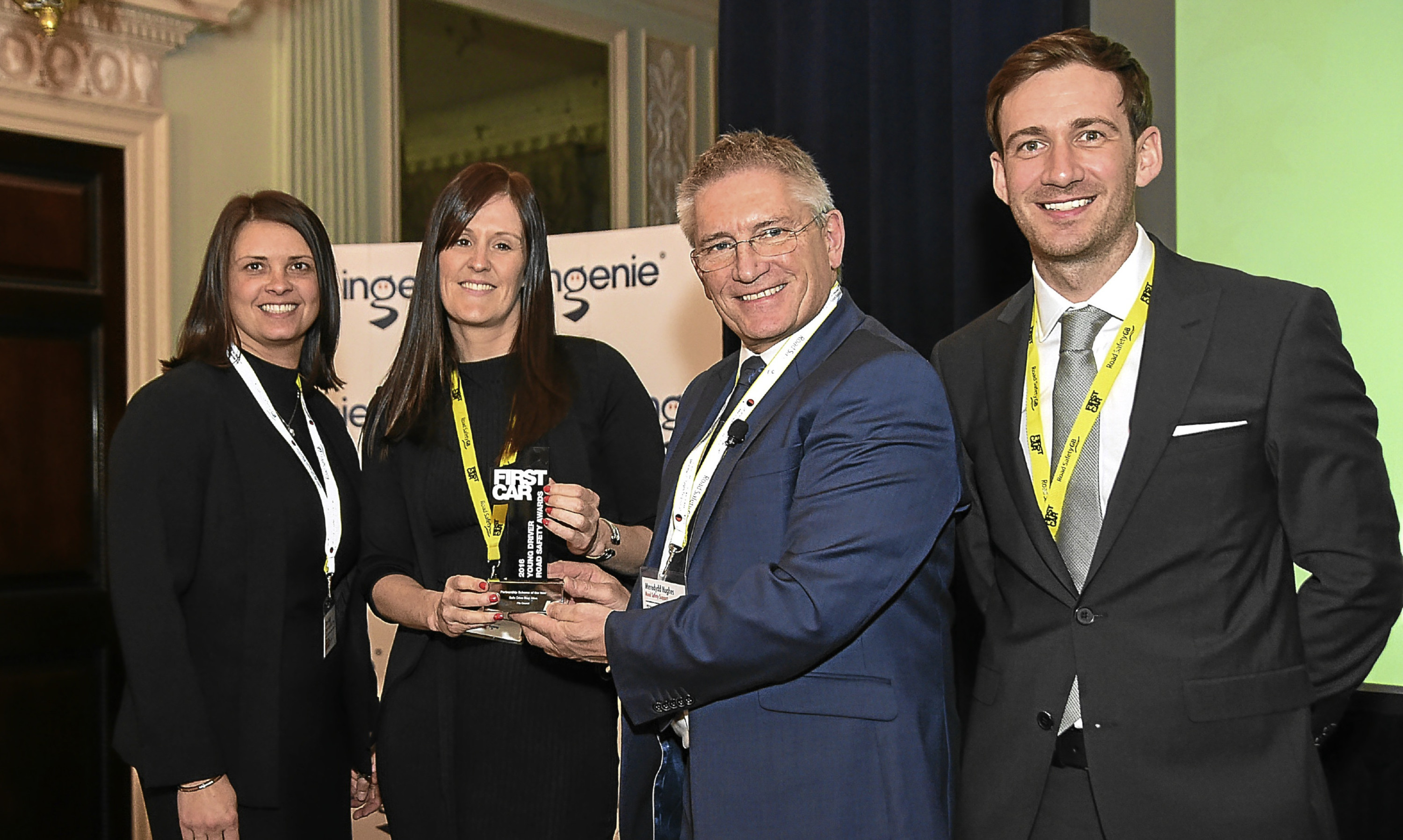 Stacey McLelland Hodge and Nicola Philp collecting the award on behalf of the team.
