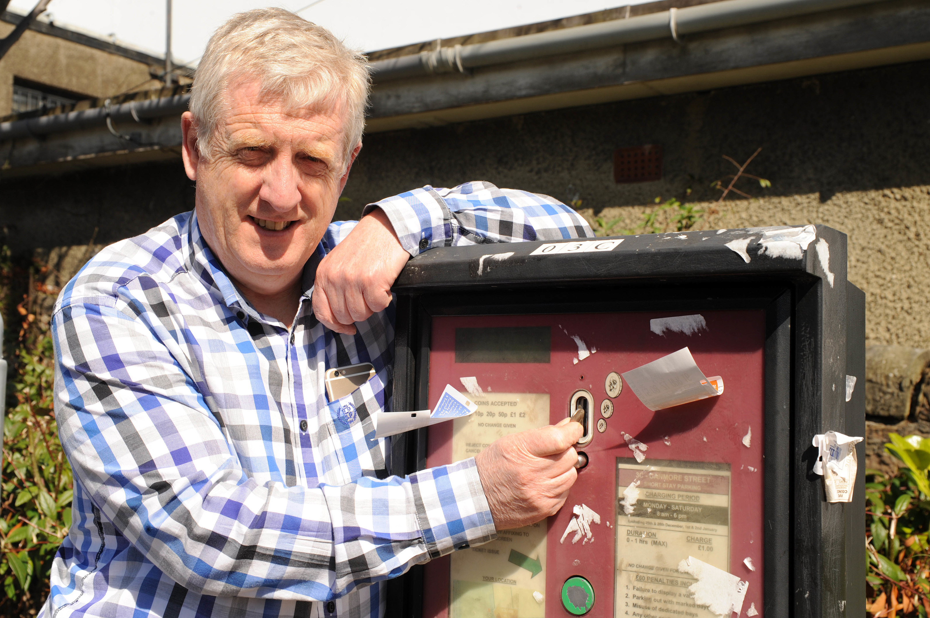 Dunfermline MP Douglas Chapman feeds a parking meter in the centre of town.
