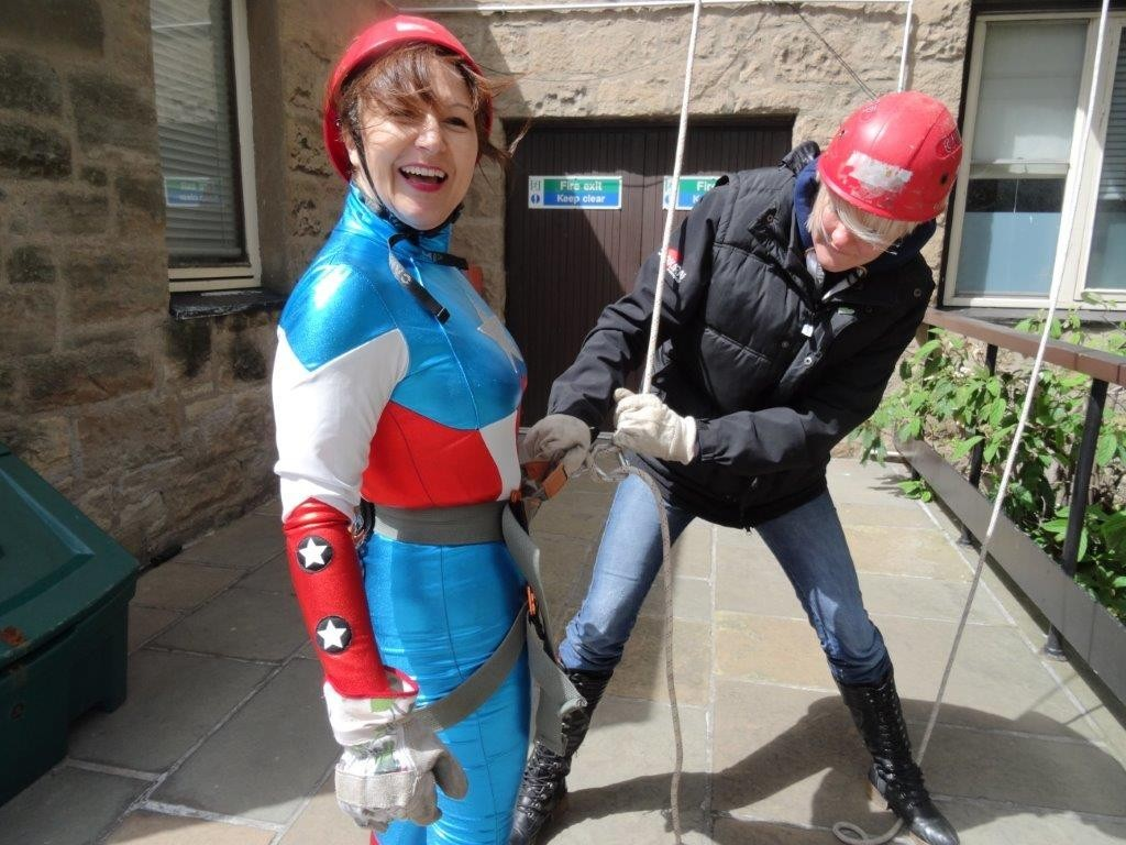 A carer takes part in a charity abseil as part of Carers Week in 2015.