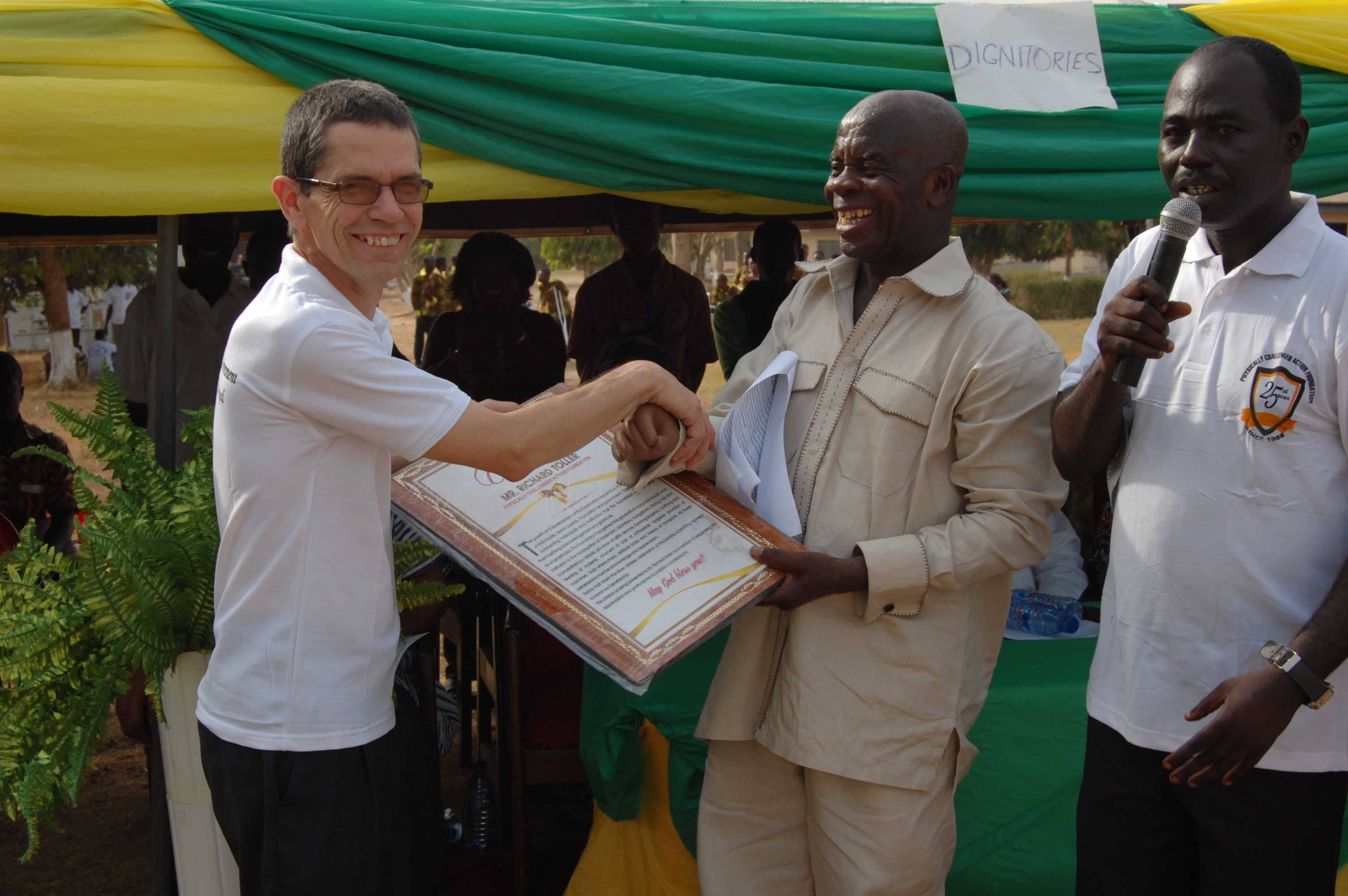 Richard receives a certificate of thanks from centre director Mr Antwi