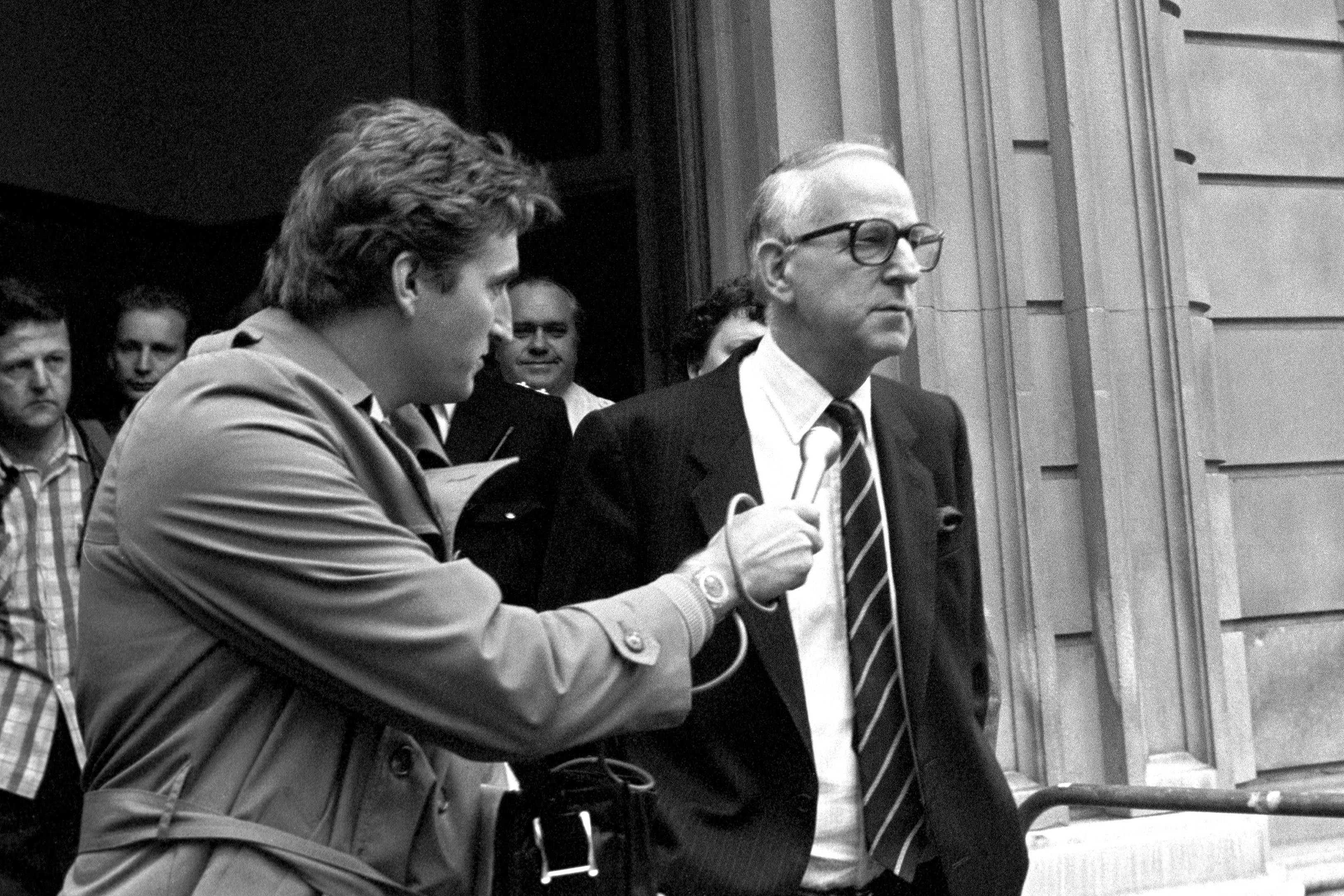 The former Guinness chairman, Ernest Saunders talks to reporters after an appearance at Bow Street Magistrates Court in 1987.