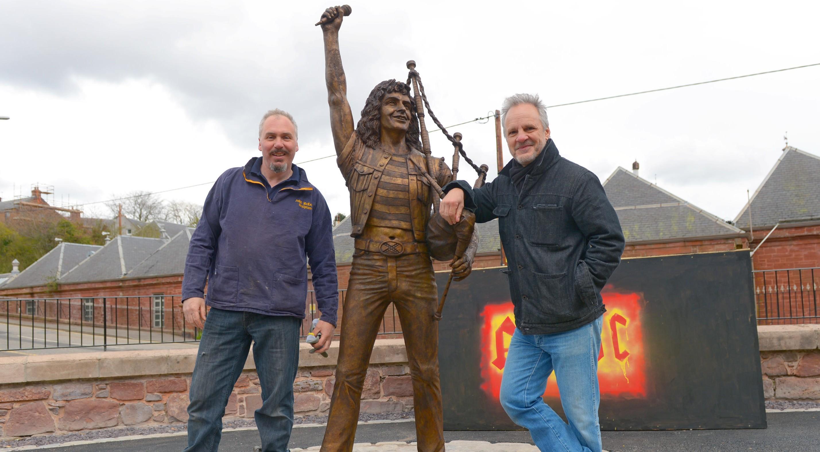 Sculptor John McKenna (left) with Mark Evans, former AC/DC bass player