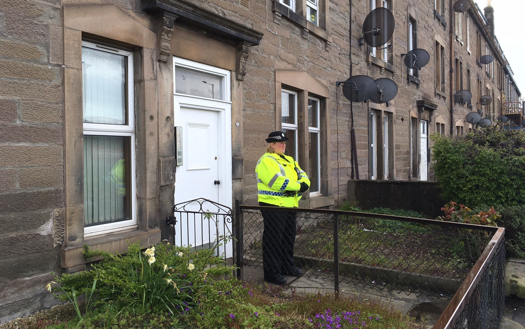 A police officer stands outside the home in Dunkeld Road where Louise O'Brien was found dead last week.