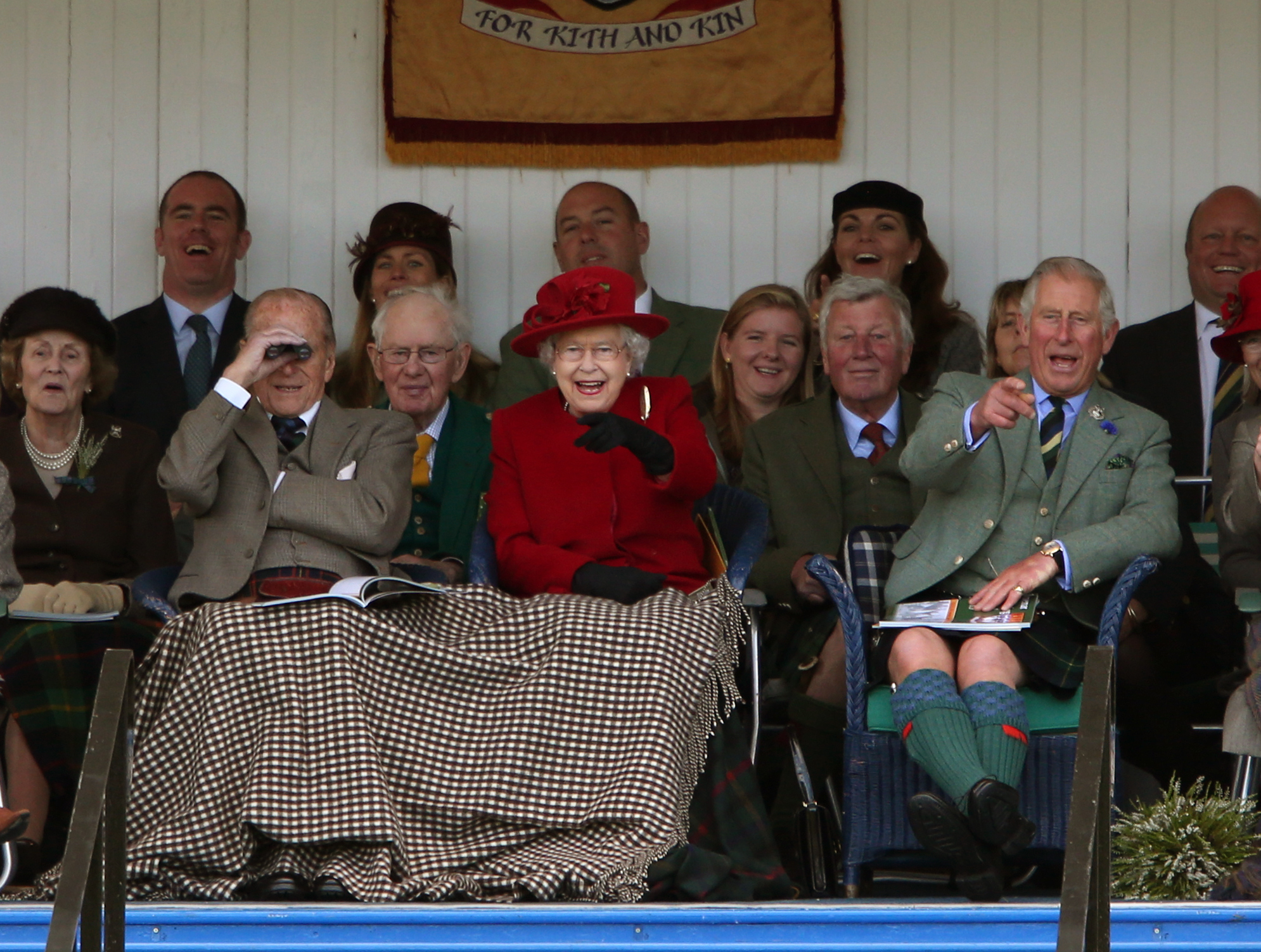 The Queen enjoys the action at Braemar Royal Highland Gathering last year.