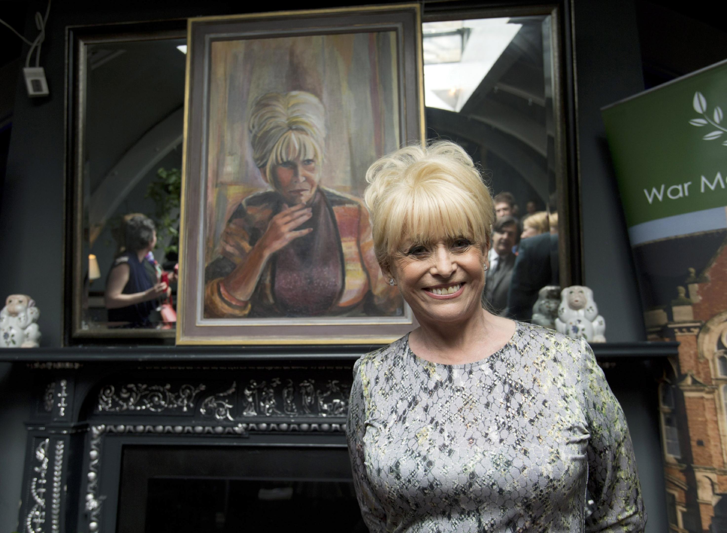 Dame Barbara Windsor unveiling a portrait of herself by Welsh artist Dan Llywelyn Hall.