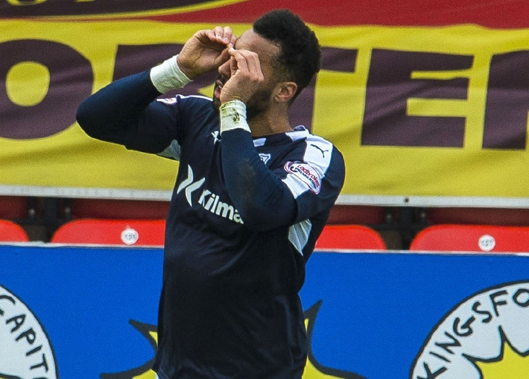 Kane Hemmings celebrates his second goal at Firhill.