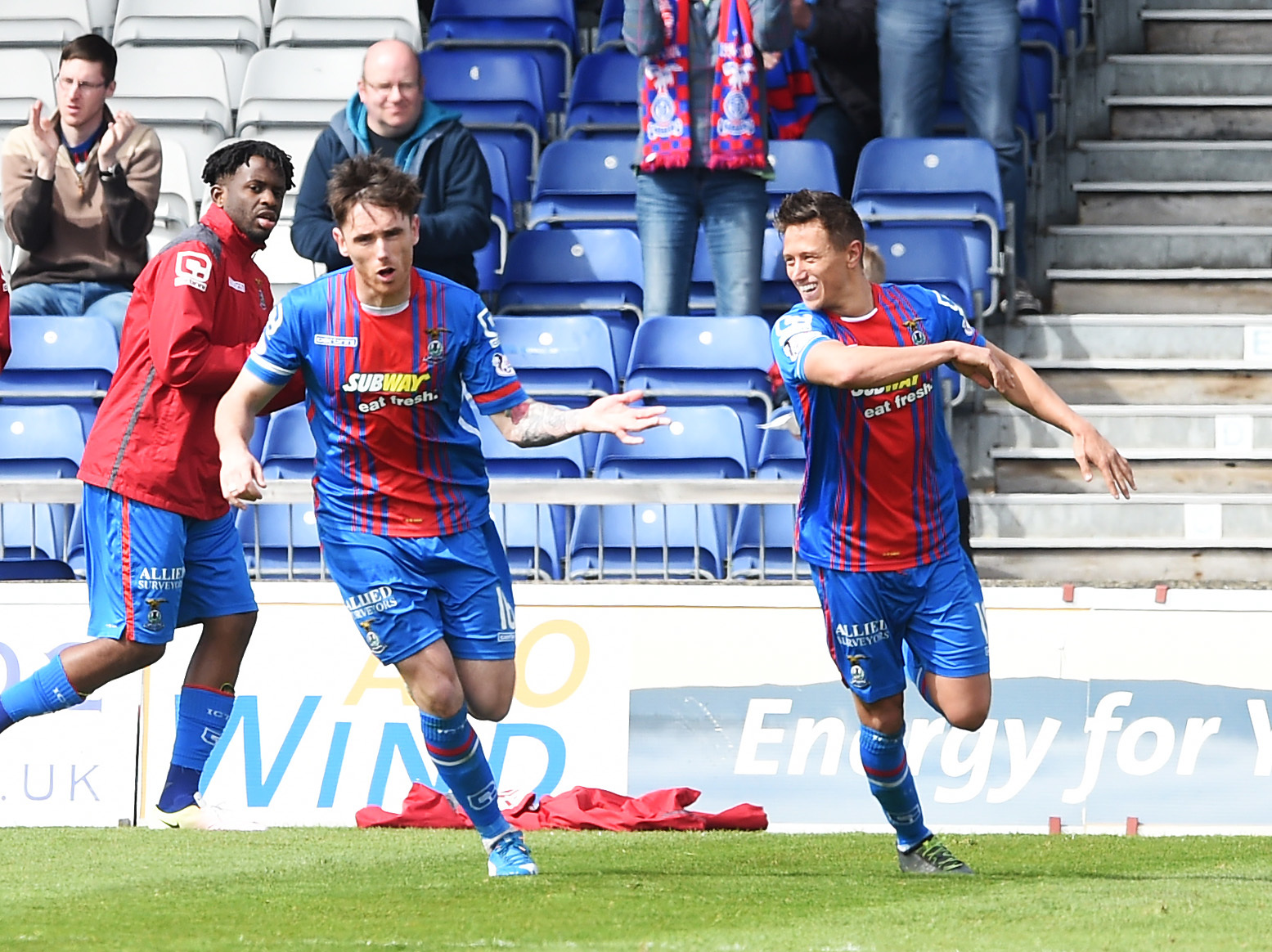 Inverness CT's Greg Tansey (left) celebrates after he scores a penalty for his side.