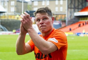 Former Dundee United midfielder John Rankin hangs up boots and aims to go into full-time coaching