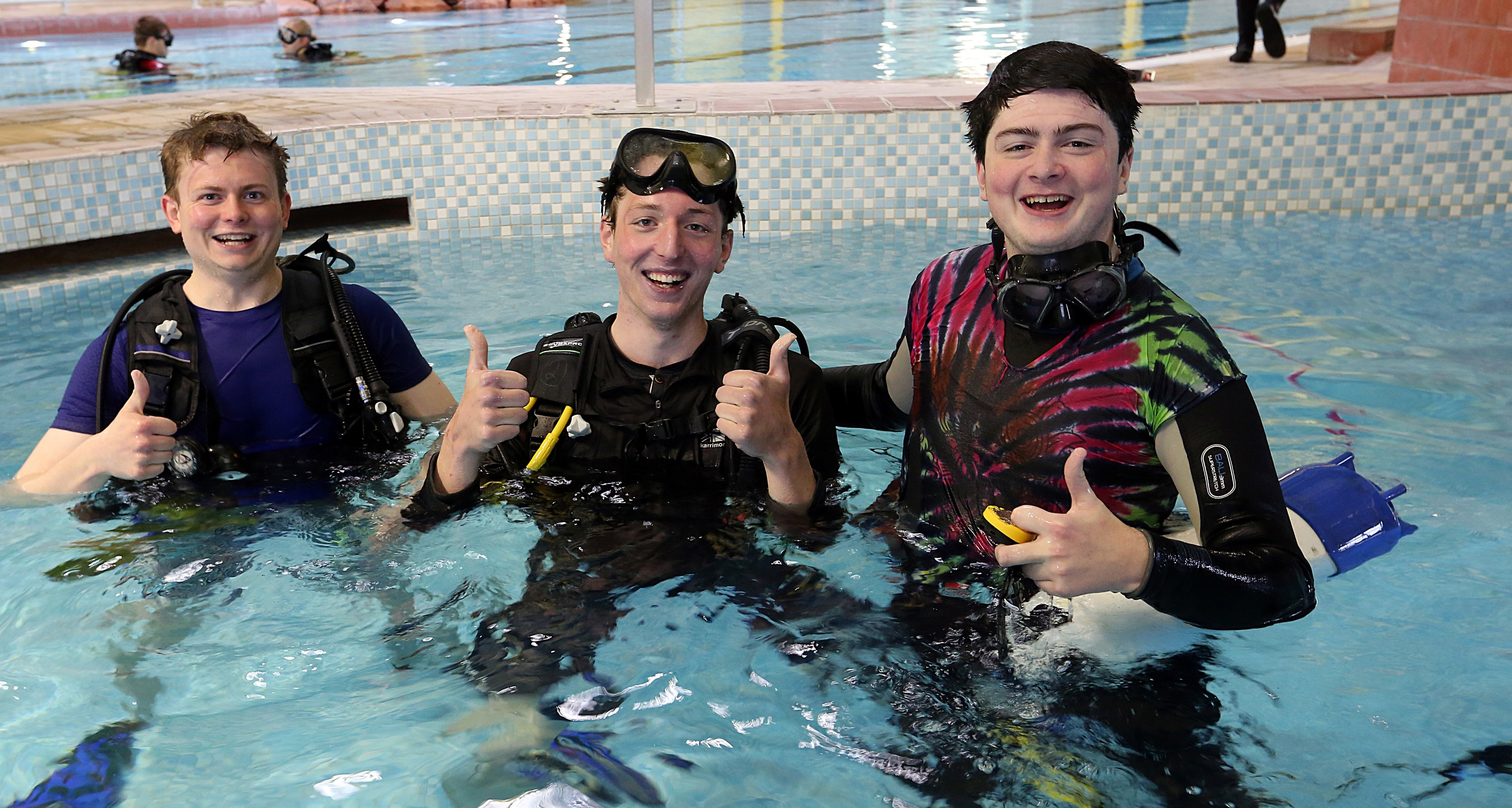 From left, Mark Jones, Harry Gunning and Neil Coupland complete three hours in the pool.