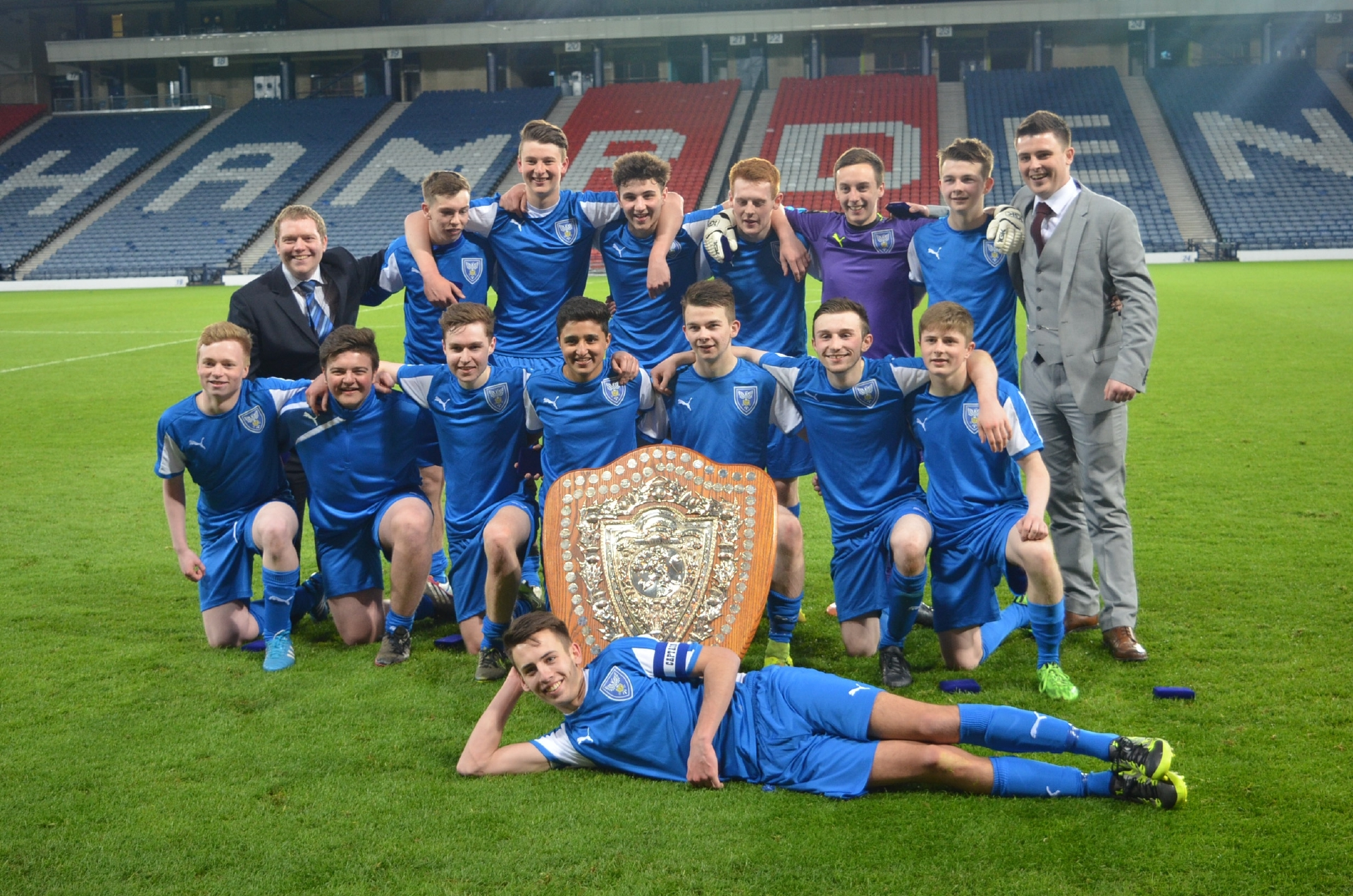 Senior pupils from St John's RC High School pose on the pitch at Hampden Park after their historic schools cup win.