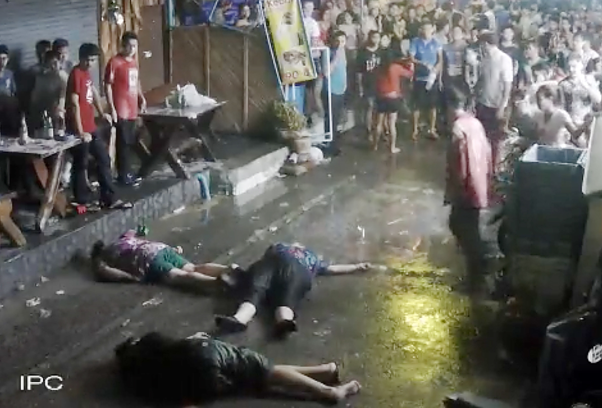 The elderly British couple and their son  on the ground after they were savagely attacked during a family vacation in Hua, Hin, Thailand.