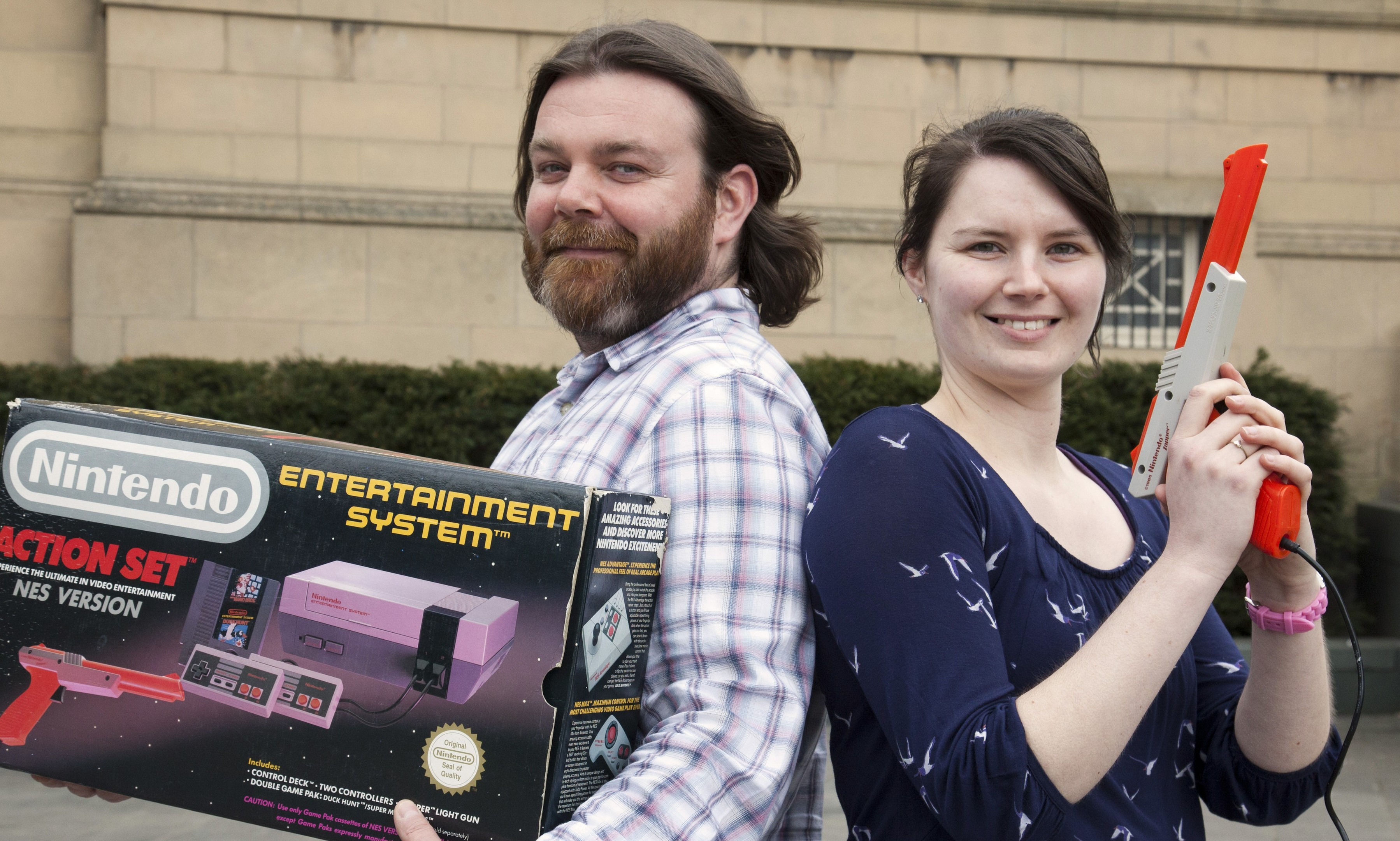 Perth Museum and Art Gallery's design and publicity officer Paul Ritchie and event officer Joanna Dick with a retro NES console.