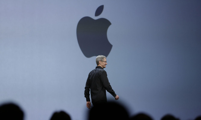 Apple CEO Tim Cook walks on stage to deliver the keynote address.