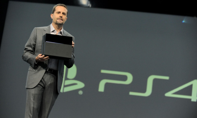 The PlayStation 4 is unveiled by Andrew House, president and group CEO of Sony Computer Entertainment.
