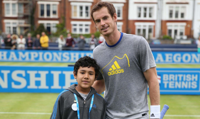 Andy Murray with Elijah Ortiz-Herrera at Queens Club.