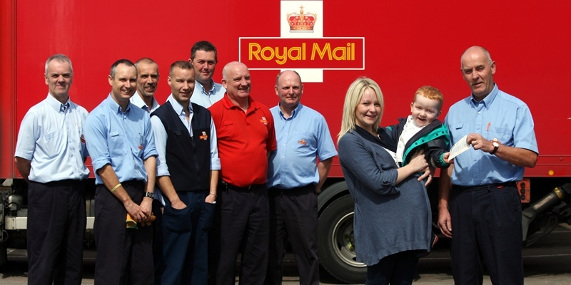 Steve MacDougall, Courier, Feus Road Royal Mail Sorting Office, Perth. Staff handing over £1,700 for Jack McNaughton. Pictured, front, left to right is Stacy McNaughton, son Jack McNaughton and presenting the cheque is George Johnston (Chairman of Royal Mail Benevolent Fund), alongside some of the staff.