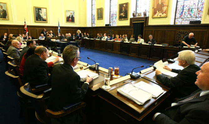 Councillors debate the biomass plans at the meeting in the city chambers.