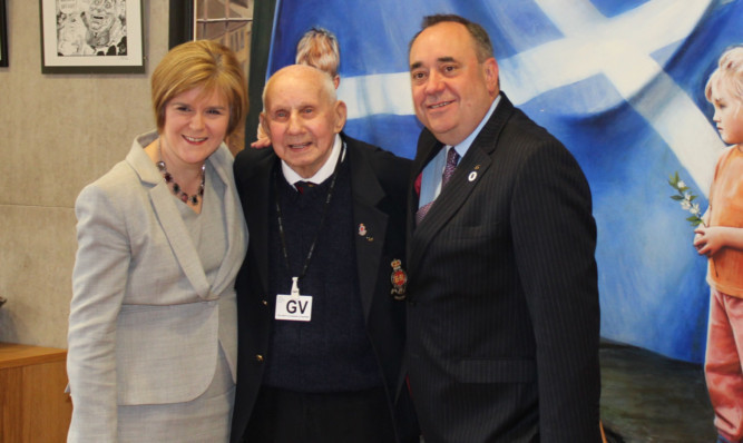 Mr Sinclair with Nicola Sturgeon and Alex Salmond at Holyrood.