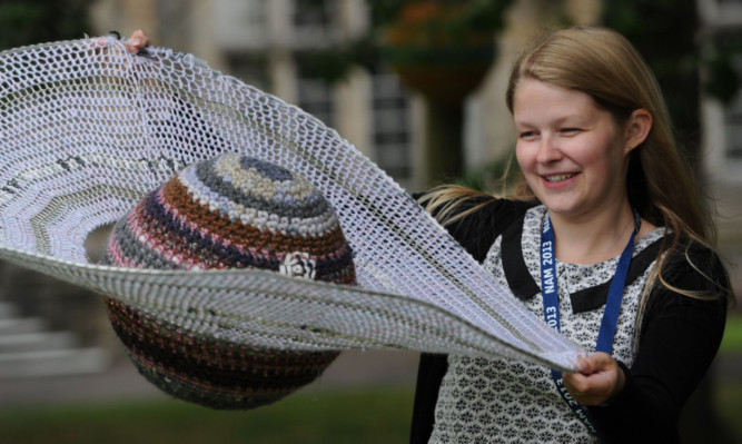 Fern Storey, Royal Astronomical Society, with a knitted Saturn.