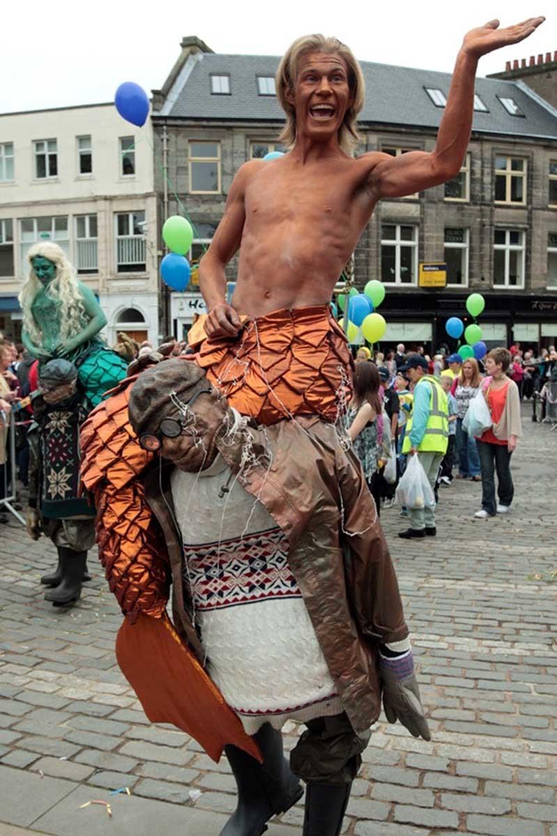 John Stevenson, Courier, 25/06/11. Fife. Dunfermline High Street, Childrens Gala Parade. Pic shows a Merman? during the parade.