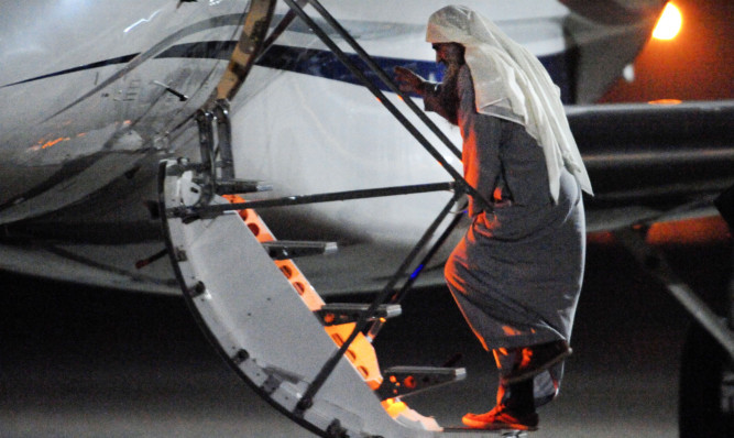 Abu Qatada boards the plane at RAF Northolt.