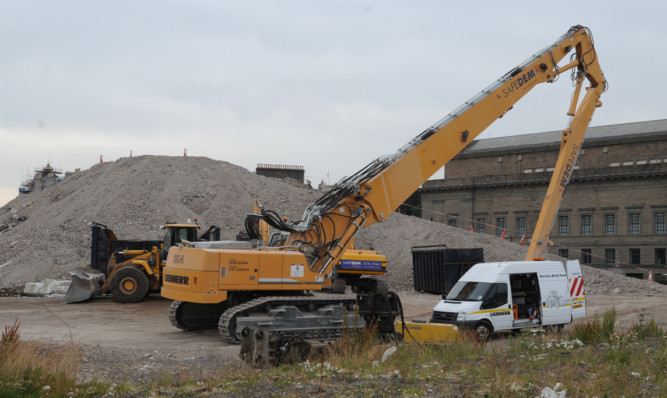 A mound of rubble is all that is left of Tayside House.