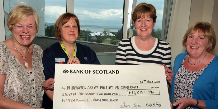 John Stevenson, Courier, 12/07/11. Dundee,Ninewells Hospital, Acute Palliative Care Unit.Presentation of £11.215.39 to the unit.Names l/r are Sheena Egan, Susan Lundie, senior charge nurse, Specialist Doctor Fiona Paterson and Trudy McLeay.