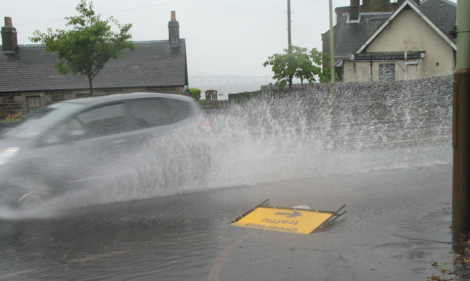 Flooding on Dundee Road at its junction with Victoria Road in Broughty Ferry.